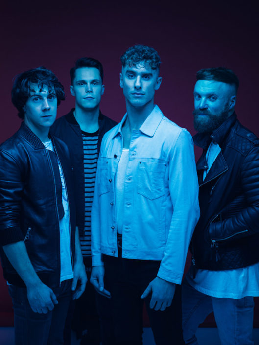 Coloured band portrait of Don Broco photographed in studio by Marcus Maschwitz