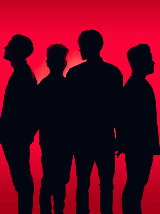 Silhouetted portrait of Young Guns photographed by Marcus Maschwitz
