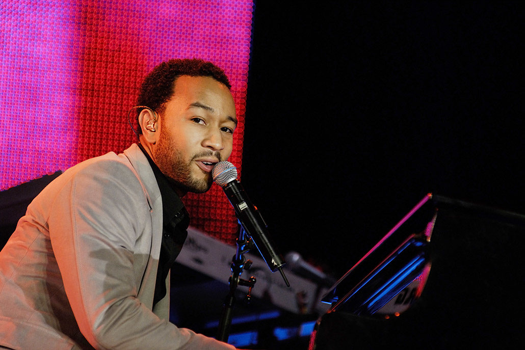 John Legend playing piano on stage in South Africa photographed by Marcus Maschwitz