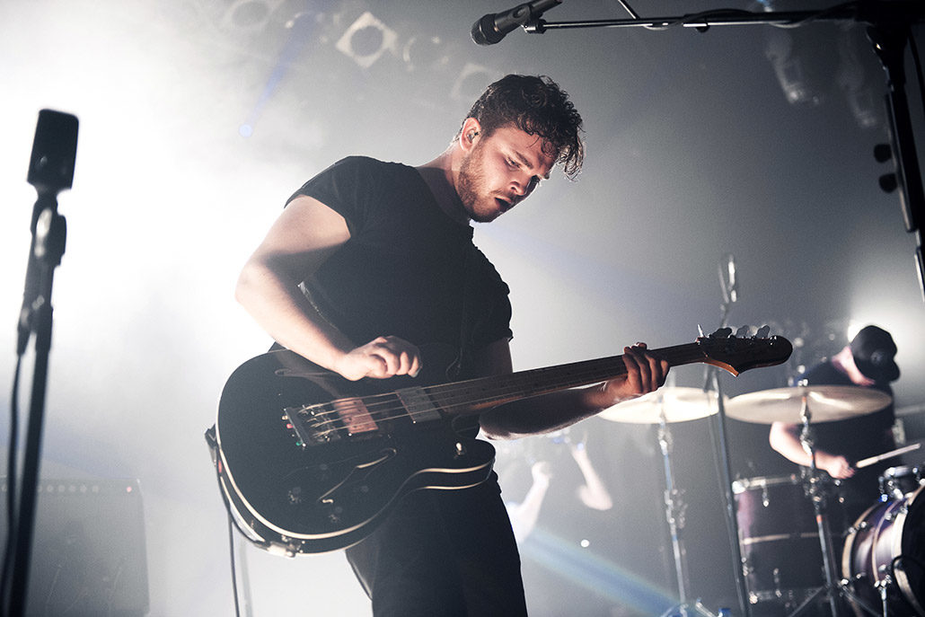 Mike Kerr of Royal Blood jamming on stage photographed by Marcus Maschwitz