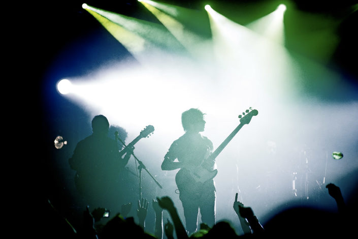 Taking Back Sunday silhouetted on stage photographed by Marcus Maschwitz