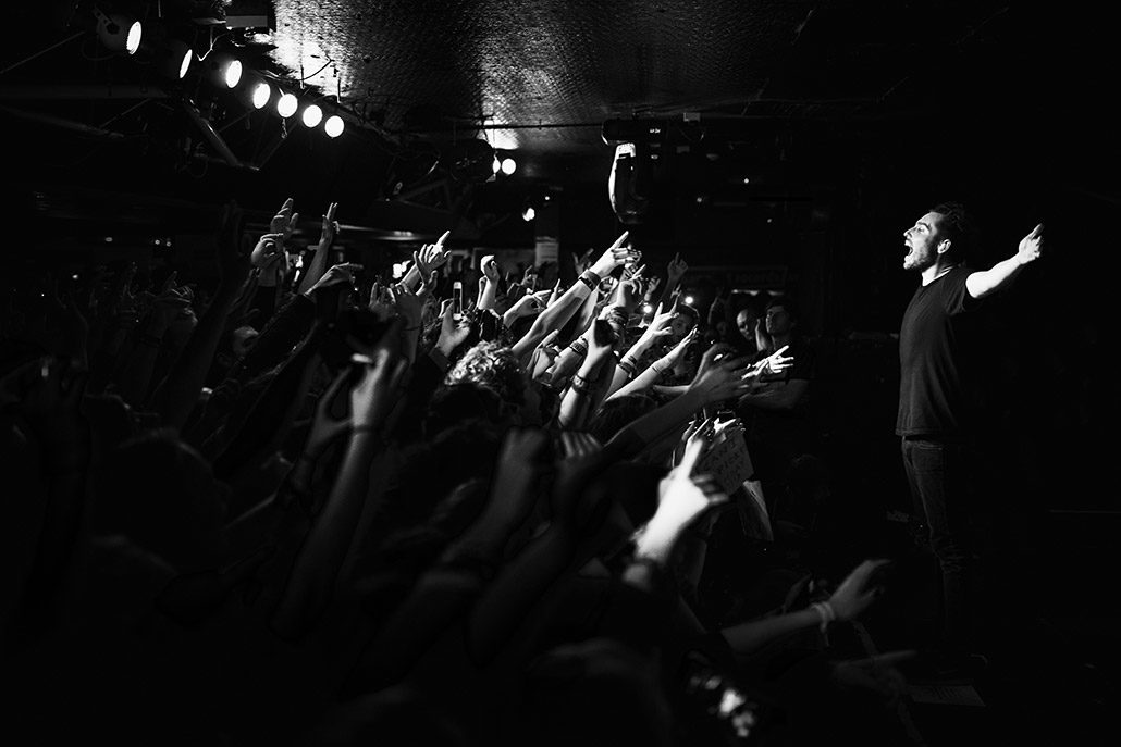 Josh Franceschi of You Me At Six feeding off the crowd during their album release show photographed by Marcus Maschwitz