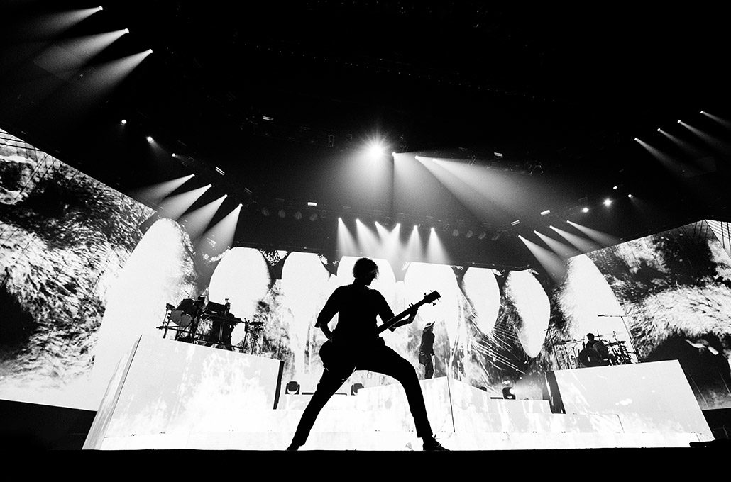 Silhouette of Matt Keen from Bring Me The Horizon playing live during their arena tour of the UK photographed by Marcus Maschwitz