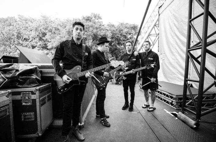 Behind The Scenes portrait of Fall Out Boy backstage at Leeds Festival photographed by Marcus Maschwitz