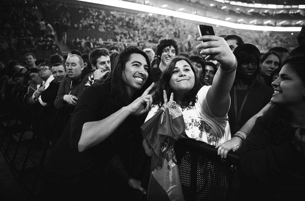 Phil Manansala of Of Mice & Men hanging out with a fan at a show in London photographed by Marcus Maschwitz