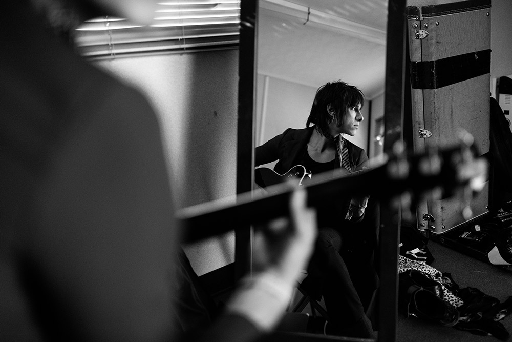 Sebastian Danzig of Palaye Royale warming up backstage at Reading Festival photographed by Marcus Maschwitz