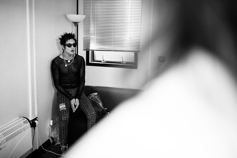 Remington Leith of Palaye Royale backstage getting ready for showtime at Reading Festival photographed by Marcus Maschwitz